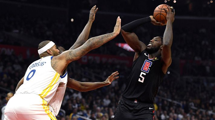 DeMarcus Cousins y Montrezl Harrell (Foto: Getty)