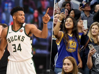 Giannis Antetokounmpo y aficionados de los Warriors (Getty Images)