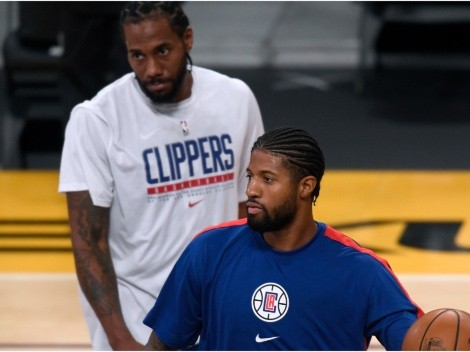 Kawhi Leonard and Paul George react after Clippers beat Lakers in season opener