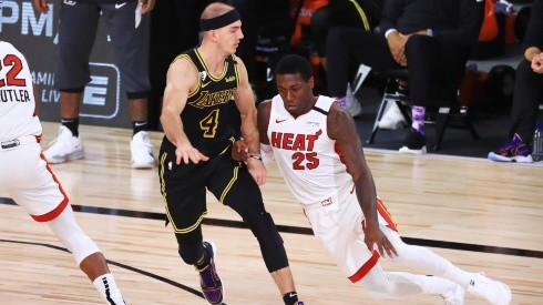 Kendrick Nunn (right) of the Miami Heat drives the ball against Alex Caruso (left) of the Los Angeles Lakers.