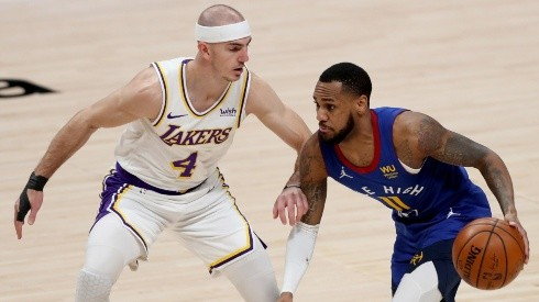 Monte Morris (right) of the Denver Nuggets is guarded by Alex Caruso (left) of the Los Angeles Lakers. (Getty)