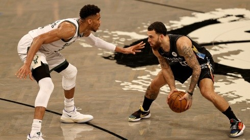 Giannis Antetokounmpo (left) of the Milwaukee Bucks guards Mike James (right) of the Brooklyn Nets. (Getty)