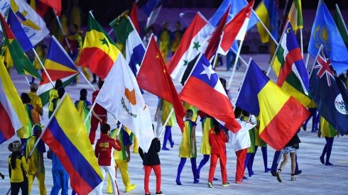 Athletes walk with flags in 2016. (Getty)