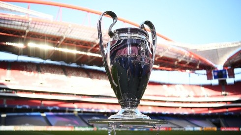 The UEFA Champions League Trophy is seen on the pitch. (Getty)