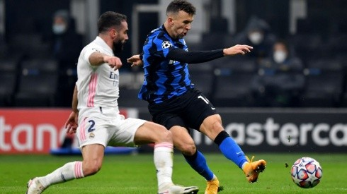 Daniel Carvajal of Real Madrid (left) tries to stop  Ivan Perisic of Inter (right) (Getty)