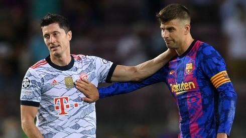 Robert Lewandowski of Bayern (l) and Gerard Pique of Barcelona. (Getty)