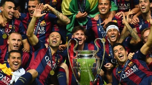 Barcelona players including Javier Mascherano, Lionel Messi, Neymar and Luis Suarez celebrate victory with the trophy after the UEFA Champions League Final between Juventus and FC Barcelona (Getty Images).