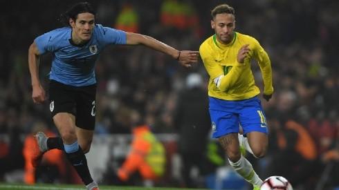 Edison Cavani of Uruguay (left) tries to stop Neymar of Brazil