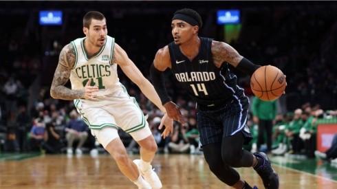 Juancho Hernangomez of Boston Celtics (left) tries to block Gary Harris of Orlando Magic