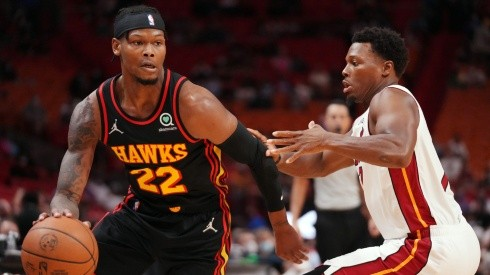Cam Reddish of the Atlanta Hawks (left) and Kyle Lowry of the Miami Heat (right)