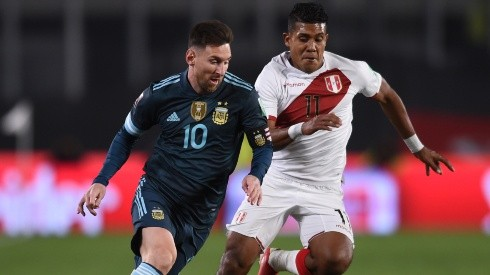 Lionel Messi against Raziel Garcia during Argentina's win over Peru.