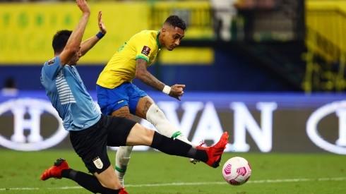 Raphinha of Brazil scores against Uruguay.