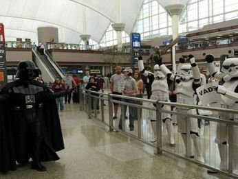 Stormtroopers greeting Darth Vader in the airport