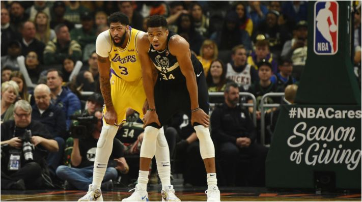 Anthony Davis and Giannis Antetokounmpo lead the DPOY race. (Getty)