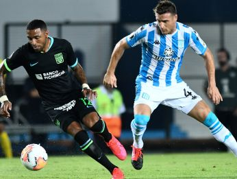 Alianza Lima vs Racing Club: Alexi Gómez of Alianza Lima (left) drives the ball against Iván Pillud of Racing Club during a Group F match (Getty).