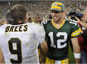 Drew Brees and Aaron Rodgers will face off again. (Getty)