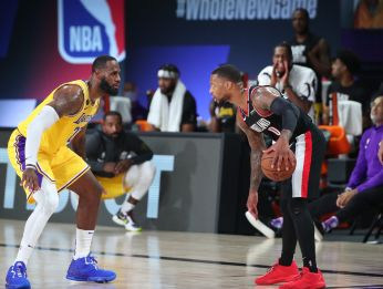 Damian Lillard and LeBron James during a game in the NBA bubble. (Getty)