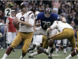 Sonny Jurgensen of the Washington Redskins trying to avoid a sack. (Getty)